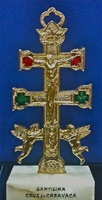 CARAVACA CROSS WITH ANGEL GOLD BASE METAL GLAZED AND STONE MARBLE BASE GR